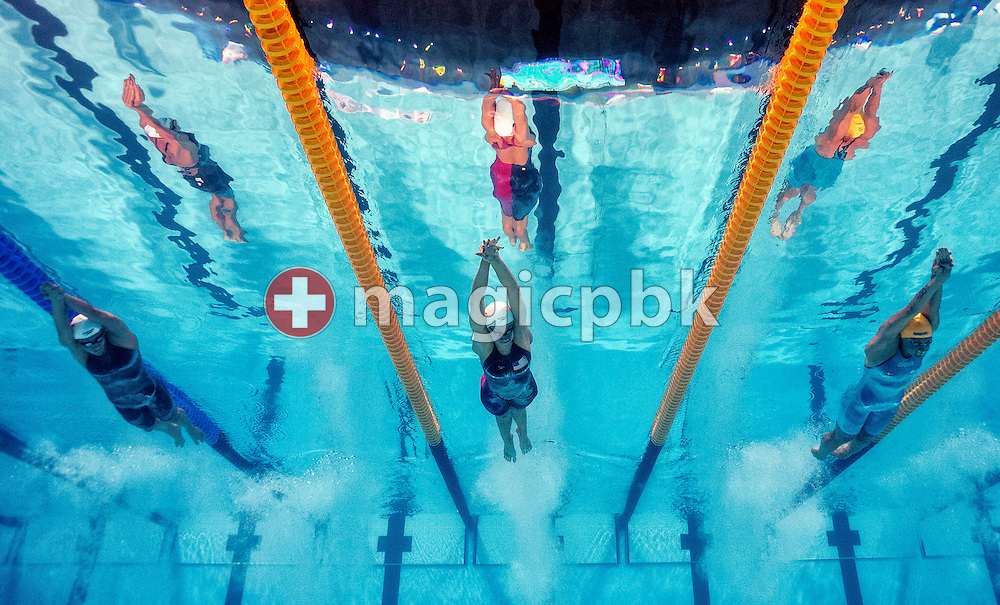 (L-R) Katerine Savard of Canada, Dana Vollmer of the United States of America (USA) and Sarah Sjostrom of Sweden compete in the women's 100m Butterfly Heats during the 15th FINA World Aquatics Championships at the Palau Sant Jordi in Barcelona, Spain, Sunday, July 28, 2013. (Photo by Patrick B. Kraemer / MAGICPBK)
