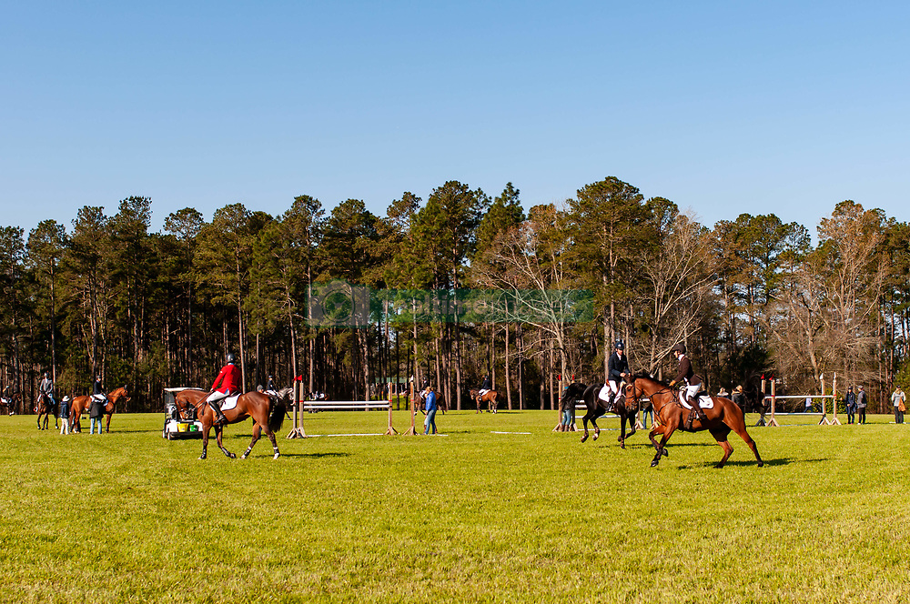 March 22, 2019 - Raeford, North Carolina, US - March 22, 2019 - Raeford, N.C., USA - Riders and horses warm-up before competing in the CCI3-S show jumping division at the sixth annual Cloud 11-Gavilan North LLC Carolina International CCI and Horse Trial, at Carolina Horse Park. The Carolina International CCI and Horse Trial is one of North AmericaÃ•s premier eventing competitions for national and international eventing combinations, hosting International competition at the CCI2*-S through CCI4*-S levels and National levels of Training through Advanced. (Credit Image: © Timothy L. Hale/ZUMA Wire)