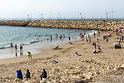 Tourists swimming and enjoying the main Beach facing the seaside town of Asilah, Morocco, 2015-08-03. <br />