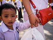 02 FEBRUARY 2013 - PHNOM PENH, CAMBODIA:  A boy holds his mother's hand while they wait in line to see the crematorium of late Cambodian King Norodom Sihanouk during the mourning period for Sihanouk, who ruled Cambodia from independence in 1953 until he was overthrown by a military coup in 1970. Sihanouk died in Beijing, China, in October 2012.      PHOTO BY JACK KURTZ