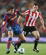 FC Barcelona's Gerard Pique (l)  and Athletic de Bilbao's Inigo Diaz de Cerio during the Supercup of Spain.August 23 2009.