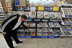 © under license to London News Pictures. LONDON, UK  03/05/2011. A news vendors stand at St James' Tube station in central London displays newspapers this morning (03 May 2011) carrying news of Osama Bin Laden's death. Photo credit should read Stephen Simpson/LNP.