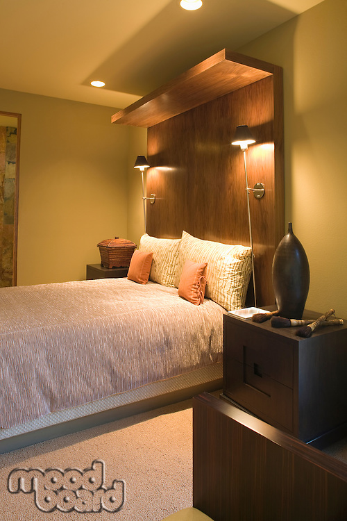 Double bed with oversized wooden headboard
