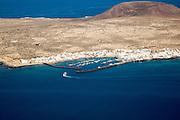 Ferry ship approaching Caleta del Sebo, La Graciosa island, Lanzarote, Canary Islands, Spain view from Mirador del Rio