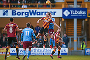 Bradford City defender Anthony McMahon (29) challenges Scunthorpe United defender, on loan from Norwich City, Harry Toffolo (15)  during the EFL Sky Bet League 1 match between Bradford City and Scunthorpe United at the Coral Windows Stadium, Bradford, England on 26 December 2016. Photo by Simon Davies.