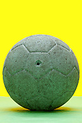 withered and battered plastic football