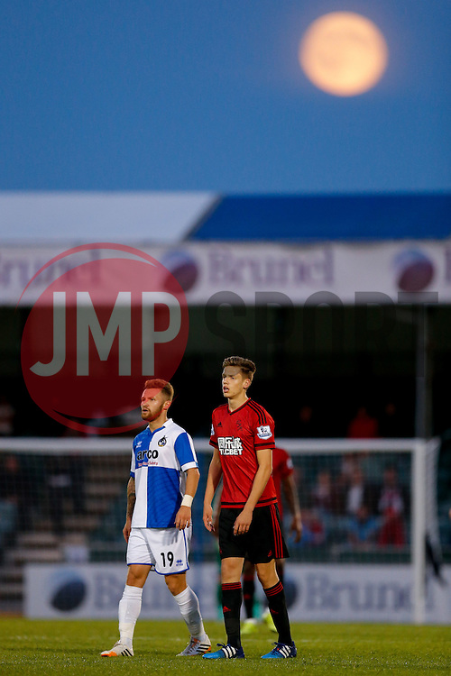 """Matt Taylor of Bristol Rovers and Jack Fitzwater of West Brom look on as a rare """"Blue Moon"""" rises over the ground during the match - Mandatory byline: Rogan Thomson/JMP - 07966 386802 - 31/07/2015 - FOOTBALL - Memorial Stadium - Bristol, England - Bristol Rovers v West Bromwich Albion - Phil Kite Testimonial Match."""