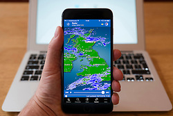 Using iPhone smartphone to display weather radar image of rain across the United Kingdom