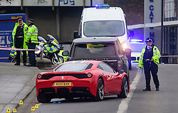 © Licensed to London News Pictures. 12/12/2016. London, UK. A red FERRARI sports car parked behind a LAND ROVER at the scene where six people have been rushed to hospital after a car ploughed in to a group of pedestrians in Battersea, South London. The Ferrari is reported to have been chasing a Land Rover at the time of the accident. Photo credit: Ben Cawthra/LNP