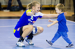 Barbara Varlec Lazovic with her son Luka after the handball match between Women National teams of Slovenia and Serbia in 2nd Round of Qualifications for 2014 EHF European Championship on October 27, 2013 in Hala Tivoli, Ljubljana, Slovenia. Slovenia defeated Serbia 31-26. (Photo by Vid Ponikvar / Sportida)