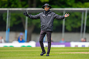 Umpire Kumar Dharmasena signals a wide during the One Day International match between Scotland and Afghanistan at The Grange Cricket Club, Edinburgh, Scotland on 10 May 2019.