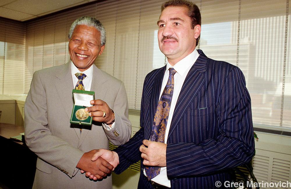 Nelson Mandela meets former wolrd heavyweight boxing champion Gerrie Coetzee, Johannesburg, South Africa.