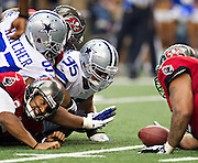 DALLAS, TX - SEPTEMBER 23:  Josh Freeman #5 of the Tampa Bay Buccaneers fumbles the ball against the Dallas Cowboys at Cowboys Stadium on September 23, 2012 in Dallas, Texas.  The Cowboys defeated the Buccaneers 16-10.  (Photo by Wesley Hitt/Getty Images) *** Local Caption *** Josh Freeman