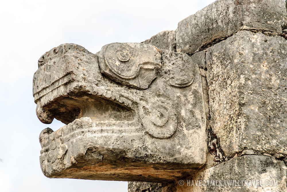 Carved stone jaguar heads adorning the buildings at Chichen Itza, Mexico.