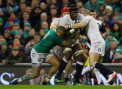 Maro Itoje of England is tackled by Simon Zebo of Ireland - Mandatory by-line: Ken Sutton/JMP - 18/03/2017 - RUGBY - Aviva Stadium - Dublin,  - Ireland v England - RBS 6 Nations