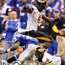 Dec 20, 2009; New Orleans, LA, USA; Southern Miss Golden Eagles wide receiver DeAndre Brown (5) is hit by Middle Tennessee State Blue Raiders safety Kevin Brown (33) during the first half of the 2009 New Orleans Bowl at the Louisiana Superdome.  Mandatory Credit: Derick E. Hingle-US PRESSWIRE