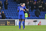 Cardiff City  Manager  Neil Warnock hugs and congratulates   Cardiff City  Souleymane Bamba (14) the goal scorer during the EFL Sky Bet Championship match between Cardiff City and Hull City at the Cardiff City Stadium, Cardiff, Wales on 16 December 2017. Photo by Gary Learmonth.