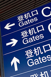 Airport signs showing way to departure gates at Beijing International Airport