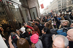 © London News Pictures. 17/11/2011. London, UK.  Shopppers try to get a glimpse of Donatella Versace at the Launch of the new Versace collection at H&M on Regent Street, London today (17/11/2011). Shoppers had queued for nearly 24 hours to be first in line for Versace's hotly anticipated collection : Ben Cawthra/LNP