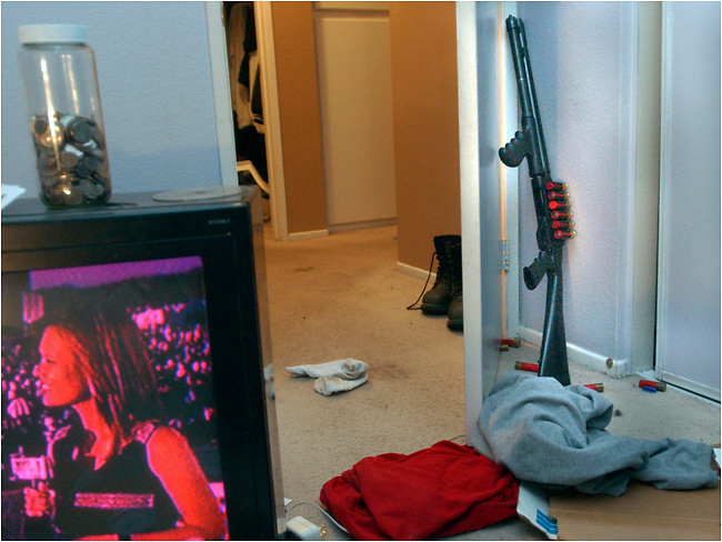 Michael Stenerson / Staff Photographer.A shotgun is seen in a bedroom of a Victorville residence where eight people were arrested for illegal guns and drugs Wednesday night.