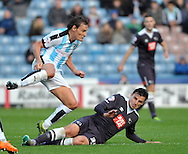George Thorne of Derby County slides in on Dean Whitehead of Huddersfield Town during the Sky Bet Championship match at the John Smiths Stadium, Huddersfield<br /> Picture by Graham Crowther/Focus Images Ltd +44 7763 140036<br /> 24/10/2015