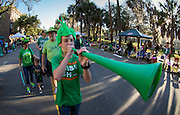 Cody Lewenberger walks with his family to their spot on the parade route before the start of the St. Patrick's Day parade, Tuesday, March 17, 2015, in Savannah, Ga. The St. Patrick's Day tradition in Savannah dates back to the first parade held on March 17, 1824. While Savannah has been celebrating St. Patrick's Day for 191 years, there have been at least six years without a parade. (AP Photo/Stephen B. Morton)
