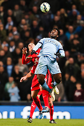 Manchester City's Wilfried Bony wins a header against Esteban Cambiasso of Leicester City  - Photo mandatory by-line: Matt McNulty/JMP - Mobile: 07966 386802 - 04/03/2015 - SPORT - football - Manchester - Etihad Stadium - Manchester City v Leicester City - Barclays Premier League