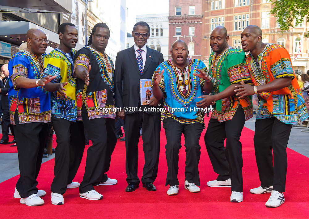 Image ©Licensed to i-Images Picture Agency. 10/06/2014. London, United Kingdom. HRH Prince Harry attends the 50th Anniversary of Zulu premiere. . Picture by Anthony Upton / i-Images<br /> Leicester Square, London, 10 June 2014: Pr. Buthelezi, with the Zulu Choir who starred in the original film at a gala screening to celebrate the 50th Anniversary of Zulu where guests were joined by Prince Harry to watch a digitally remastered version of the iconic film. The evening was arranged to raise money for two charities supported by Prince Harry, Walking With The Wounded and Sentebale. <br /> For further info please contact<br /> Emily Conrad-Pickle Captive Minds<br /> Mobile: +44 (0)7799 414 790<br /> emily.conrad-pickles@captiveminds.com