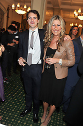VISCOUNT ERLEIGH and  JULIA IMMONEN at a reception for The Mirela Fund in partnership with Hope and Homes for Children hosted by Natalie Pinkham in The Churchill Room, House of Commons, London on 30th April 2013.
