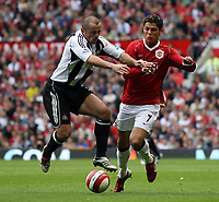 Photo: Paul Thomas.<br /> Manchester United v Newcastle United. The Barclays Premiership. 01/10/2006.<br /> <br /> Cristiano Ronaldo (R) of Man Utd is fouled by Stephen Carr.