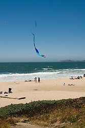 People enjoying the beach at Half Moon Bay Beach, .San Mateo Coast of California, south of San Francisco.  Photo copyright Lee Foster, 510-549-2202, lee@fostertravel.com, www.fostertravel.com. Photo 444-31157