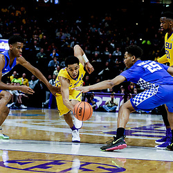 Jan 3, 2018; Baton Rouge, LA, USA; LSU Tigers guard Tremont Waters (3) drives between Kentucky Wildcats guard Shai Gilgeous-Alexander (22) and forward PJ Washington (25) during the second half at the Pete Maravich Assembly Center. Kentucky defeated LSU 74-71.  Mandatory Credit: Derick E. Hingle-USA TODAY Sports