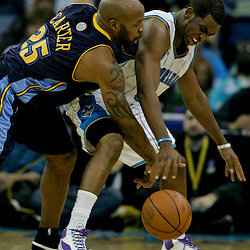 Dec 18, 2009; New Orleans, LA, USA;  New Orleans Hornets guard Chris Paul (3) and Denver Nuggets guard Anthony Carter (25) fight for a loose ball during the second half at the New Orleans Arena. The Hornets defeated the Nuggets 98-92. Mandatory Credit: Derick E. Hingle-US PRESSWIRE