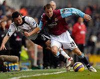 Photo: Alan Crowhurst.<br />Fulham v West Ham United. The Barclays Premiership. 23/12/2006. Lee Bowyer of West Ham (R) holds of Tomaz Radzinski.