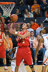Virginia Military forward Willie Bell (2) gets a shot off against UVA.  The Virginia Cavaliers defeated the Virginia Military Institute Keydets 107-97 in NCAA Basketball at the John Paul Jones Arena on the Grounds of the University of Virginia in Charlottesville, VA on November 16, 2008.