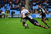 Wasps centre Juan de Jongh  takes down Exeter Chiefs wing Olly Woodburn  during the Aviva Premiership match between Wasps and Exeter Chiefs at the Ricoh Arena, Coventry, England on 18 February 2018. Picture by Dennis Goodwin.