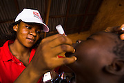A health worker vaccinates a child during a national polio immunization exercise at the Moglaa primary school in the town of Moglaa, northern Ghana on Friday March 27, 2009.