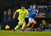Hartlepool United Striker Scott Fenwick and Portsmouth defender Christian Burgess during the Sky Bet League 2 match between Portsmouth and Hartlepool United at Fratton Park, Portsmouth, England on 12 December 2015. Photo by Adam Rivers.