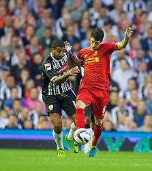LIVERPOOL, ENGLAND - Tuesday, August 27, 2013: Liverpool's Luis Alberto in action against Notts County's Joss Labadie during the Football League Cup 2nd Round match at Anfield. (Pic by David Rawcliffe/Propaganda)