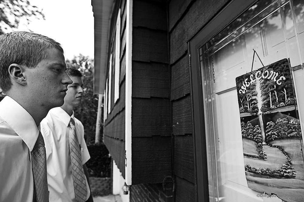 Elder Barker, left, and Elder Balls wait in front of a house in The Plains, Ohio, on Saturday, May 31, 2008. Most people do not open their door to the missionaries and of those that do, seldom are interested in their message.