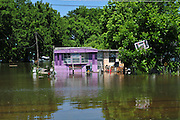 8/15/11} Vicksburg} -- Hope and faith float along these flooded homes in RailRoad Alley, Vicksburg Mississippi Sunday May 15,2011. The mighty Mississippi River threatens to flood CoolSprings Church in the Kings Community, most of the congregations homes are flooded, but many showed up early Sunday May 15, 2011 for church services. PHOTO©SUZI ALTMAN.COM.Photo by Suzi Altman.