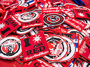 27 JULY 2013 - BANGKOK, THAILAND:   Thai Red Shirt patches for sale at the birthday party for Thaksin Shinawatra. The Red Shirts celebrated former Prime Minister Thaksin Shinawatra's 64th birthday with a party at Phibun Prachasan School in Bangkok. They had a Buddhist Merit Making Ceremony, dinner, cake and entertainment. Most of the Red Shirt political elite traveled to Hong Kong for a party with Thaksin. Thaksin, the former Prime Minister, was deposed by a coup in 2006 and subsequently convicted of corruption related crimes. He went into exile rather than go to jail but remains very popular in rural parts of Thailand. His sister, Yingluck Shinawatra is the current Prime Minister and was elected based on her brother's recommendation.   PHOTO BY JACK KURTZ