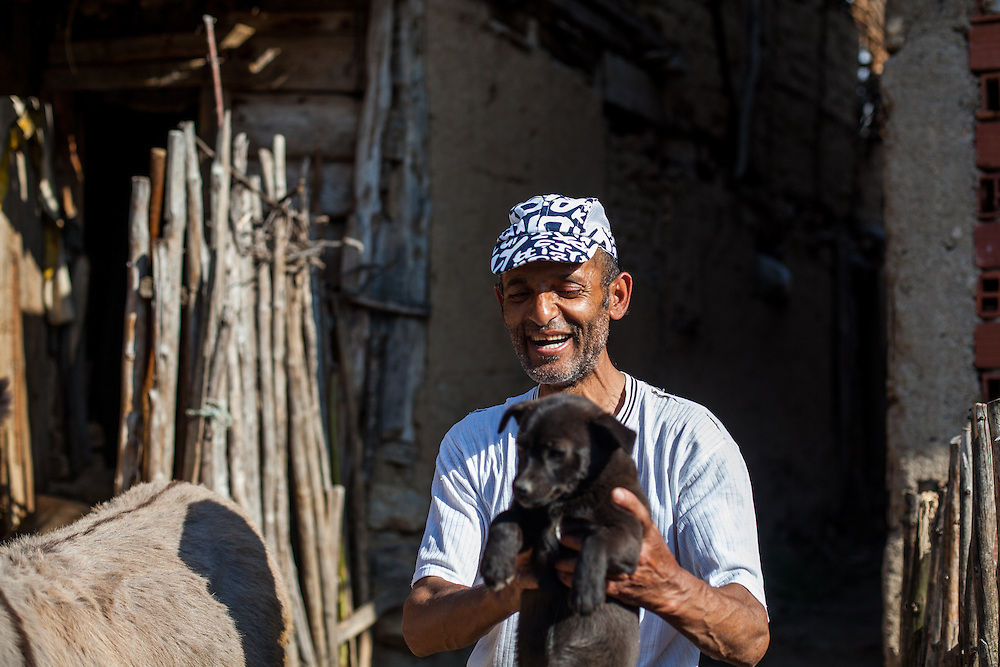 Portrait of a man with his puppy at the Roma part in the city of Crnik.