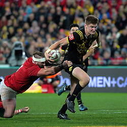 Joe Marler tries to stop Jordie Barrett during the 2017 DHL Lions Series rugby match between the Hurricanes and British & Irish Lions at Westpac Stadium in Wellington, New Zealand on Tuesday, 27 June 2017. Photo: Dave Lintott / lintottphoto.co.nz