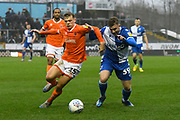 Kieran Dewsbury-Hall (15) of Blackpool battles for possession with Josh Barrett (39) of Bristol Rovers during the EFL Sky Bet League 1 match between Bristol Rovers and Blackpool at the Memorial Stadium, Bristol, England on 15 February 2020.