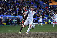 Tranmere Rovers' Matthew Pennington under pressure from Carlisle United&rsquo;s Lewis Guy. Skybet football league 1 match, Tranmere Rovers v Carlisle United at Prenton Park in Birkenhead, England on Saturday 29th March 2014.<br /> pic by Chris Stading, Andrew Orchard sports photography.