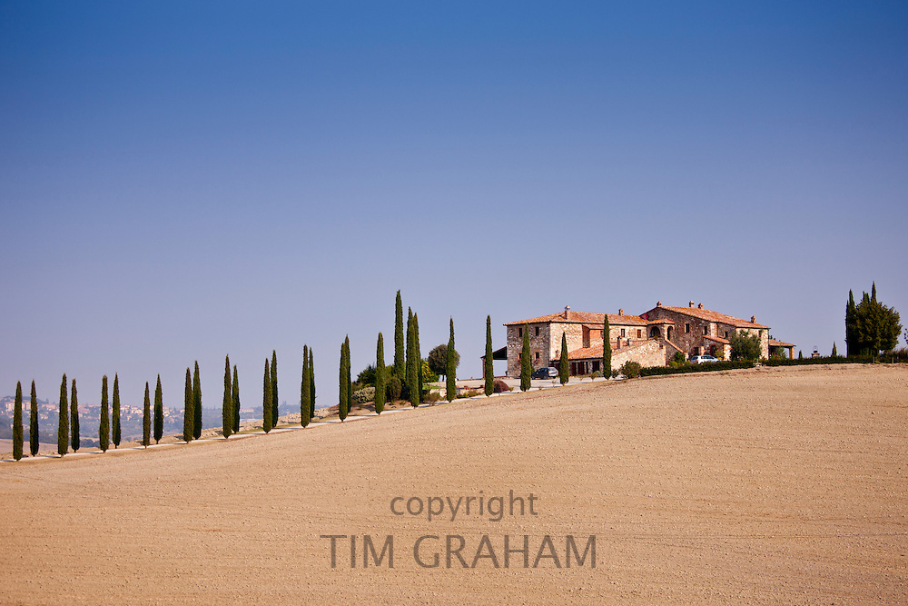 Typical Tuscan farmhouse and landscape in Val D'Orcia, Tuscany, Italy