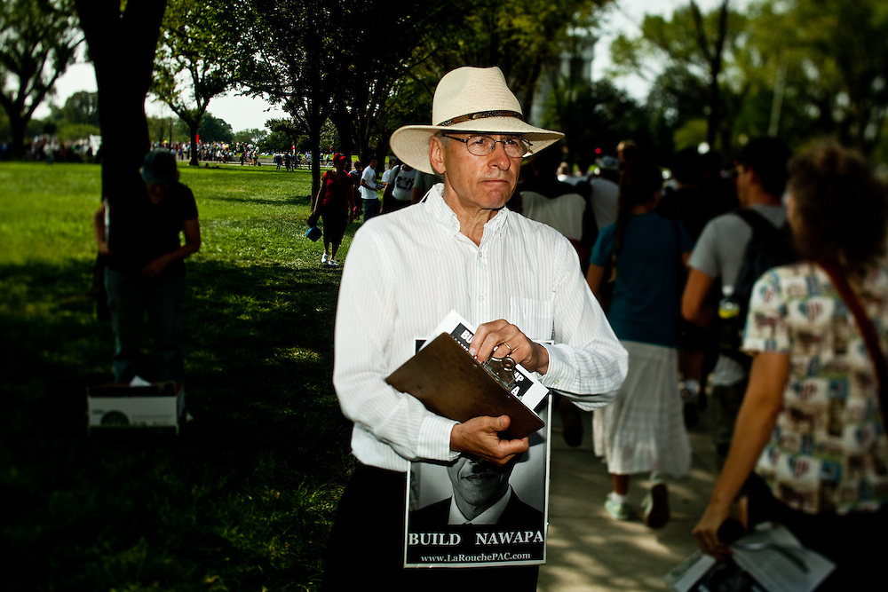 Supporters to Lyndon LaRouche hand out flyers during the 'Restoring Honor' event at the Lincoln Memorial on August 28, 2010 in Washington, DC.