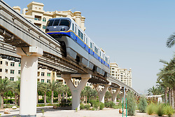 Overhead monorail railway transporting passengers to The Atlantis Hotel on The Palm Jumeirah island in Dubai United Arab Emirates