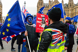 Pro-Brexit campaigner James Goddard in his 'gilet juane' once again visits and attempts to disrupt Steve Bray's SODEM anti-Brexit protest the day after he was seen harassing former cabinet minister Anna Soubry. Westminster, London, December 20 2018.